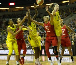 Jordin Canada, Kristi Toliver, Natasha Howard, Elena Delle Donne and Breanna Stewart battle for a rebound. Neil Enns/Storm Photos.