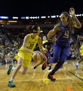Sue Bird drives past Brittney Griner to the rim. Neil Enns/Storm Photos.