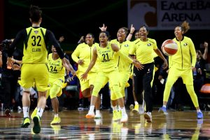 The Storm rejoice as the final buzzer sounds. Photo courtesy of Seattle Storm.