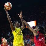 Natasha Howard rises to score over Myisha Hines-Allen. Neil Enns/Storm Photos.