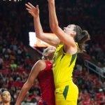 Breanna Stewart scores over Elena Delle Donne. Neil Enns/Storm Photos.