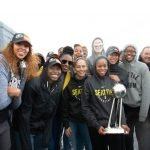 The Seattle Storm pose with the trophy after the flag-raising is complete. Neil Enns/Storm Photos.