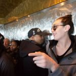 Players, coaches and staff ascend in the elevator. Neil Enns/Storm Photos.
