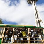 The player trolley passes by the Space Needle. Neil Enns/Storm Photos.