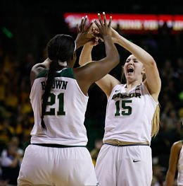 Baylor Bears center Kalani Brown, left, and forward Lauren Cox react after a made basket and foul call on the Texas Longhorns last January. Ray Carlin-USA TODAY Sports, via Baylor Bears.