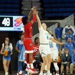 Taja Cole shoots over Lindsey Corsaro. Maria Noble/WomensHoopsWorld.