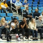 UCLA alumni Jordin Canada and Kelli Hayes watch their former teammates. Maria Noble/WomensHoopsWorld.