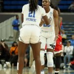 Michaela Onyenwere and Kennedy Burke conference at mid-court. Maria Noble/WomensHoopsWorld.