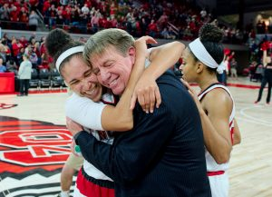 Wes Moore gets a hug from Miah Spencer after the Wolfpack upset Notre Dame in December, 2016. Photo courtesy of North Carolina State athletics.