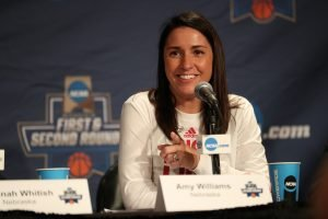 Nebraska coach Amy Williams answers questions after practice at the NCAA Tournament last winter. Photo by Scott Bruhn/NU Communications.