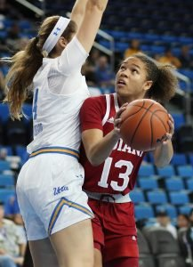 Jaelynn Penn weaves around Lindsey Corsaro to score. Photo by Maria Noble/WomensHoopsWorld.