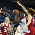 Michaela Onyenwere splits the Indiana defense. Photo by Maria Noble/WomensHoopsWorld.