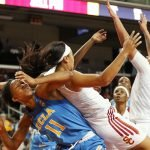 Players fight for ball possession. Maria Noble/WomensHoopsWorld.