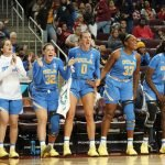 The Bruin bench watches in excitement as the third quarter run unfolds. Maria Noble/WomensHoopsWorld.