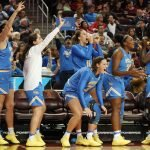 The UCLA bench celebrates a three-point shot. Maria Noble/WomensHoopsWorld.