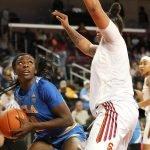 Michaela Onyenwere keeps her eye on the basket before scoring. Maria Noble/WomensHoopsWorld.