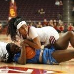 Michaela Onyenwere and Minyon Moore struggle for ball possession, Maria Noble/WomensHoopsWorld.