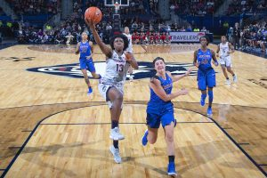 Christyn Williams powers a layup to score. Photo courtesy of UConn Athletics.