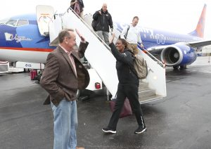 Vic Schaefer and Johnnie Harris high-five upon arrival in Columbus last March for the Final Four. Kelly Price/Mississippi State Athletics.