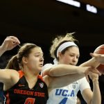 Mikayla Pivec and Lindsey Corsaro battle for ball possession. Maria Noble/WomensHoopsWorld.