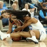 Mikayla Pivec and Lajahna Drummer battle for ball possession. Maria Noble/WomensHoopsWorld.