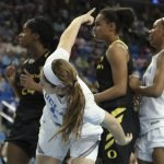 Lindsey Corsaro indicates ball possession to the Bruins. Maria Noble/WomensHoopsWorld.