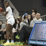 Michaela Onyenwere inbounds the ball in front of the Oregon bench. Maria Noble/WomensHoopsWorld.