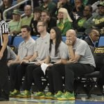 Oregon coaches watch a foul shot. Maria Noble/WomensHoopsWorld.