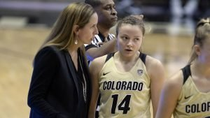 Coach JR Payne and Kennedy Leonard confer at a game pause. Photo courtesy of Colorado Athletics.