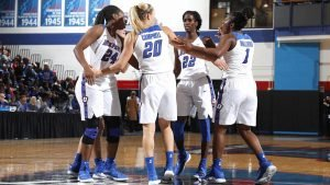 DePaul players huddle at a pause in the game. Photo courtesy of DePaul Athletics.