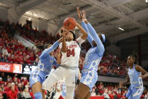 Erika Cassell splits the North Carolina defense. Chris Baird photo.