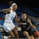 Kiana Moore drives on Lajahna Drummer. Maria Noble/WomensHoopsWorld.