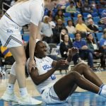 Michaela Onyenwere is helped up after a foul. Maria Noble/WomensHoopsWorld.
