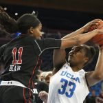 Erika Bean defends Lauryn Miller. Maria Noble/WomensHoopsWorld.