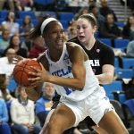 Lajahna Drummer looks to pass. Maria Noble/WomensHoopsWorld.