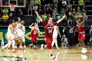 Hoosier players celebrate their upset win over Texas as the final buzzer sounds. Craig Bisacre, IU Athletics photo.