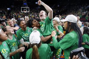 Ruthy Hebard hoists Sabrina Ionescu and the rest of the Ducks celebrate their first Final Four appearance in program history. Photo courtesy of Oregon Athletics.