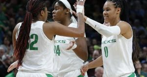 Oti Gildon and Satou Sabally high-five after a basket against South Dakota State. Photo courtesy of Oregon Athletics.