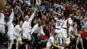 Louisville players celebrate an NCAA Tournament win two months ago. Photo courtesy of Louisville Athletics.