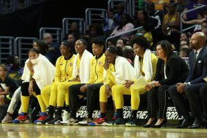 The Sparks bench watches the Mystics' lead mount at a game early in the 2019 season. Maria Noble/WomensHoopsWorld.