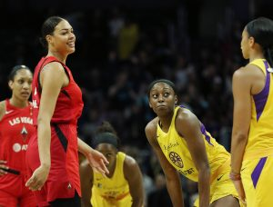 Liz Cambage and Candace Parker have words before tipoff. Maria Noble/WomensHoopsWorld.
