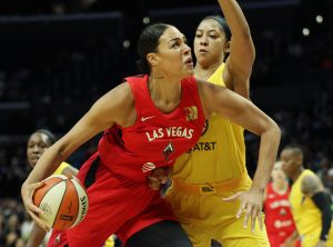 Liz Cambage drives against Candace Parker. Maria Noble/WomensHoopsWorld.