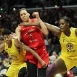 Alana Beard and Kalani Brown guard Liz Cambage. Maria Noble/WomensHoopsWorld.