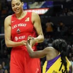 Liz Cambage helps Chiney Ogwumike up. Maria Noble/WomensHoopsWorld.