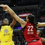 Chiney Ogwumike shoots over A'ja Wilson. Maria Noble/WomensHoopsWorld.