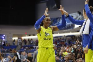 ARLINGTON, TX - JUNE 15: Kayla Thornton #6 of the Dallas Wings high fives her teammates during the game against the Atlanta Dream on June 15, 2019 at College Park Center in Arlington, Texas. NOTE TO USER: User expressly acknowledges and agrees that, by downloading and/or using this photograph, user is consenting to the terms and conditions of the Getty Images License Agreement. Mandatory Copyright Notice: Copyright 2019 NBAE (Photo by Tim Heitman/NBAE via Getty Images)