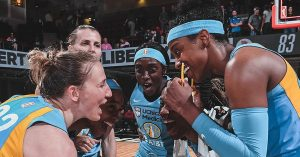 Chicago Sky players converge after a win. NBAE/Getty Images via Chicago Sky.