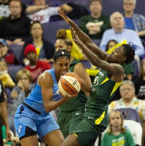 Monique Billings retains ball possession against Natasha Howard's defense. Neil Enns/Storm photos.