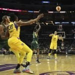 Nneka Ogwumike passes to Candace Parker. Maria Noble/WomensHoopsWorld