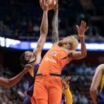 Connecticut Sun guard Courtney Williams (10) has her shot blocked by Los Angeles Sparks forward Candace Parker (3) during the WNBA Semi-Finals between the Los Angeles Sparks and the Connecticut Sun at Mohegan Sun Arena, Uncasville, Connecticut, USA on September 19, 2019. Photo Credit: Chris Poss